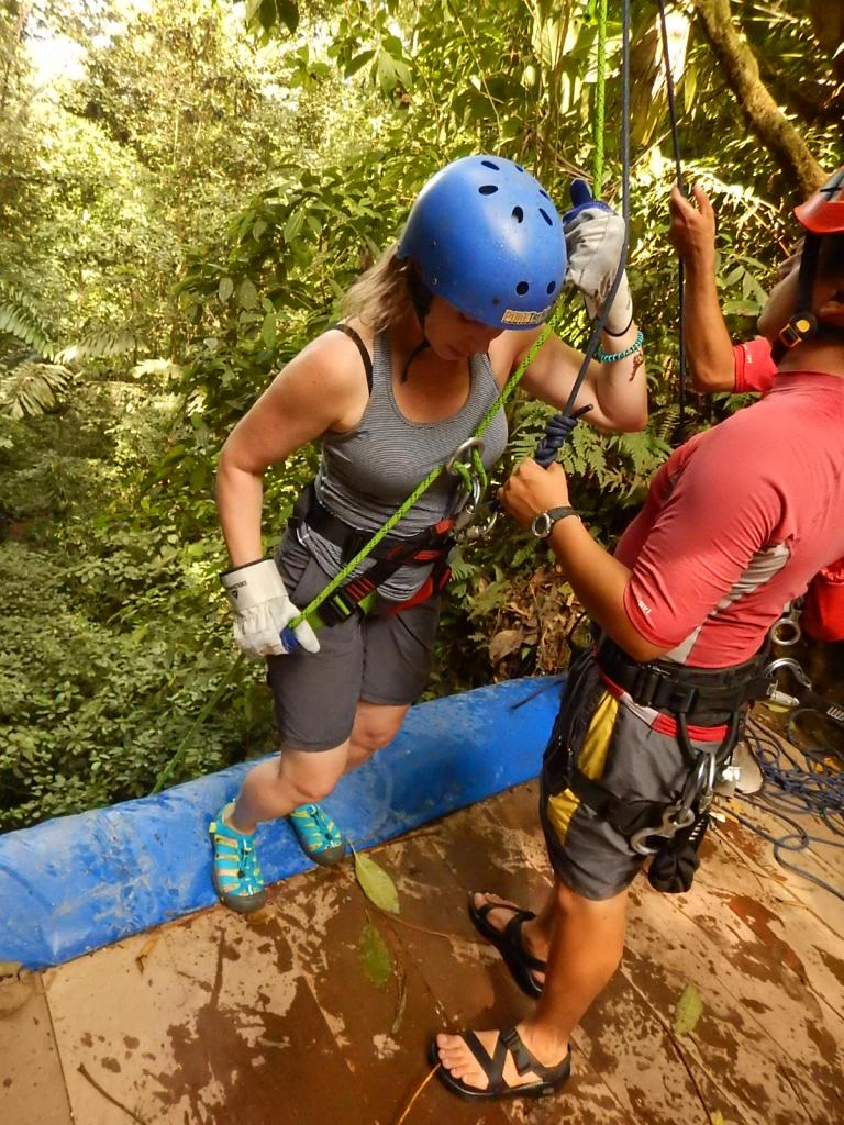 Tracey Noonan of Wicked Good Cupcakes rappelling a waterfall